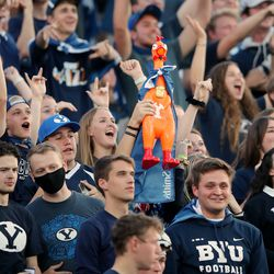 Fans sing and dance prior to watching BYU and USF play a college football game at LaVell Edwards Stadium in Provo on Saturday, Sept. 25, 2021.