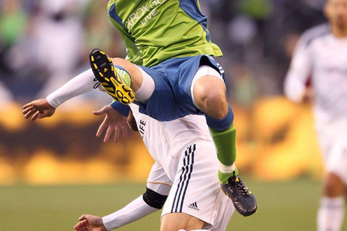 SEATTLE - OCTOBER 31:  Osvaldo Alonso #6 of the Seattle Sounders FC battles Alan Gordon #21 of the Los Angeles Galaxy during the 1st leg playoff game at Qwest Field on October 31 2010 in Seattle Washington. (Photo by Otto Greule Jr/Getty Images)