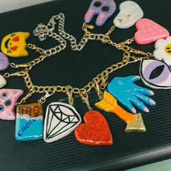 """<b>The Pick:</b> Martha's charms range from $20 to $30, but she makes them in limited batches so when they're gone, they're gone. Check the <a href=""""https://www.etsy.com/shop/BuriedDiamond?section_id=11472105&ref=shopsection_leftnav_1"""">Buried Diamond Etsy"""