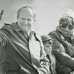 BYU head football coach LaVell Edwards waves during a parade on June 9, 1986.