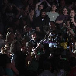Green Day's Billie Joe Armstrong, center, performs at EnergySolutions Arena in Salt Lake City Sunday.
