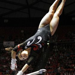 Corrie Lothrop of Utah performs on the bars during the Pac-12 gymnastics championships at the Huntsman Center in Salt Lake City, Saturday, March 24, 2012.