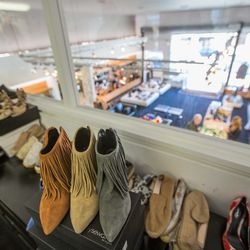 The design office overlooks the store's shoe department.
