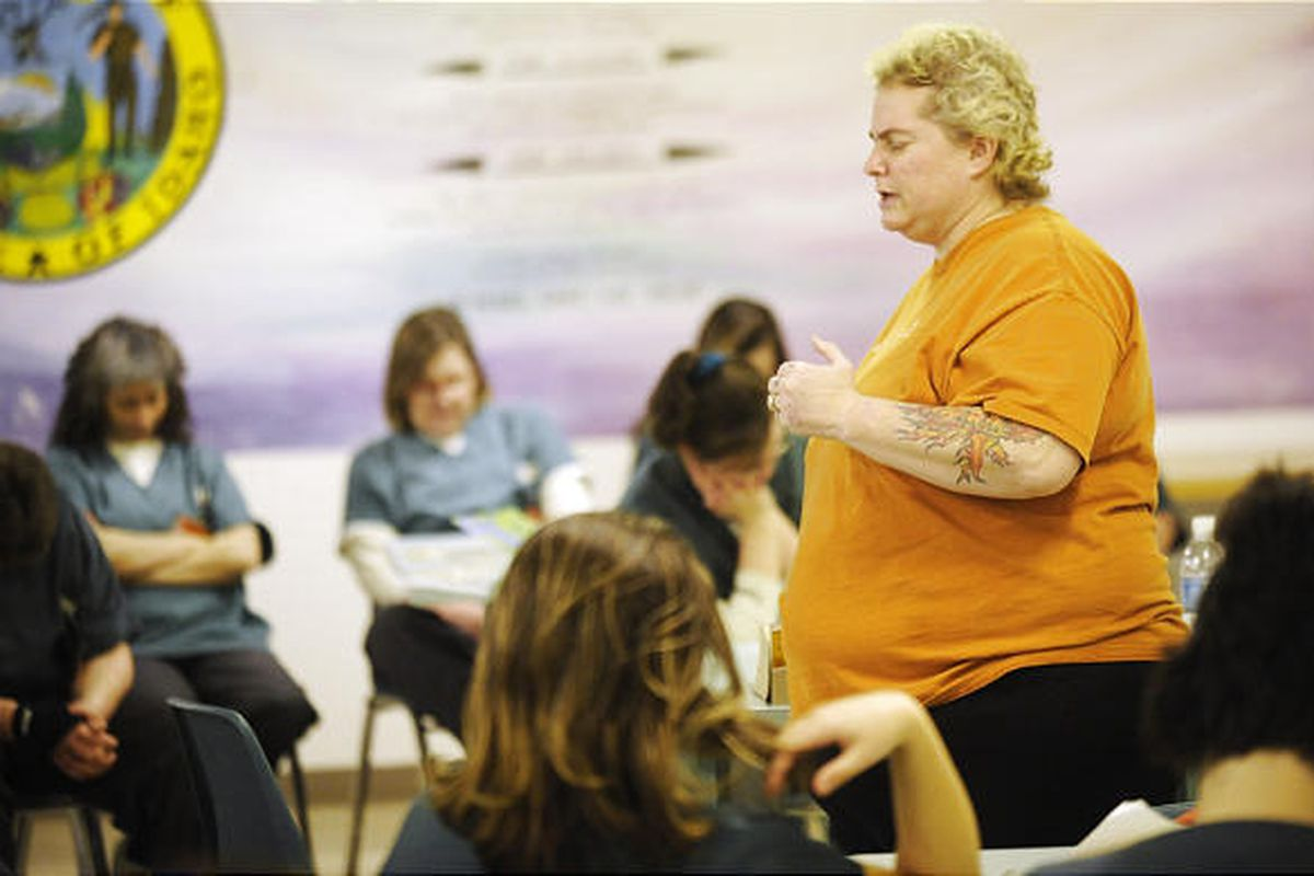Svann Langford leads a group of women in prayer to start her visit at the Pocatello Women's Correctional Center.