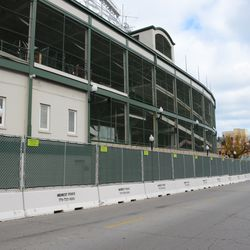 "12:37 p.m. ""Jersey"" barricades lined up along Addison Street -"