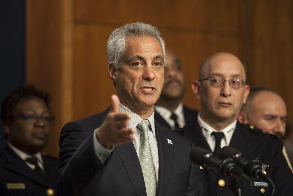 Interim Police Supt. John Escalante listens as Mayor Rahm Emanuel speaks at a Dec. 30 news conference.   Ashlee Rezin/Sun-Times