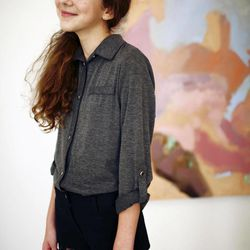 In this photo provided by IA Agency  Friday Sept 7, 2012, Isabella Rose Taylor wears one of her clothing designs at her home studio in Austin, Texas.