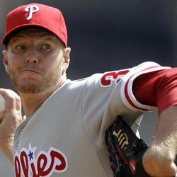 Philadelphia Phillies pitcher Roy Halladay throws during the first inning of the season opening baseball game against the Pittsburgh Pirates in Pittsburgh Thursday, April 5, 2012.