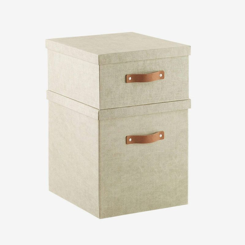 Two linen boxes stacked on top of each other.