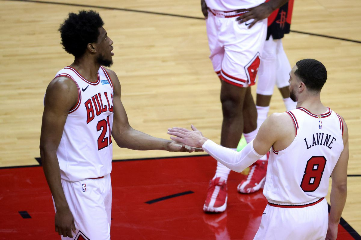 Thaddeus Young high fives Zach LaVine of the Chicago Bulls during the third quarter against the Houston Rockets at Toyota Center.