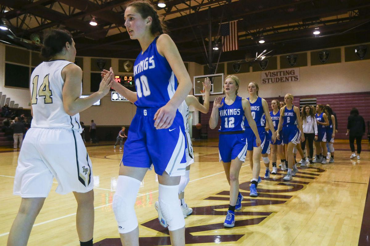 Pleasant Grove players line up after the game with Lone Peak players at Lone Peak High School in Highland on Thursday, Jan. 24, 2019. Lone Peak beat Pleasant Grove.