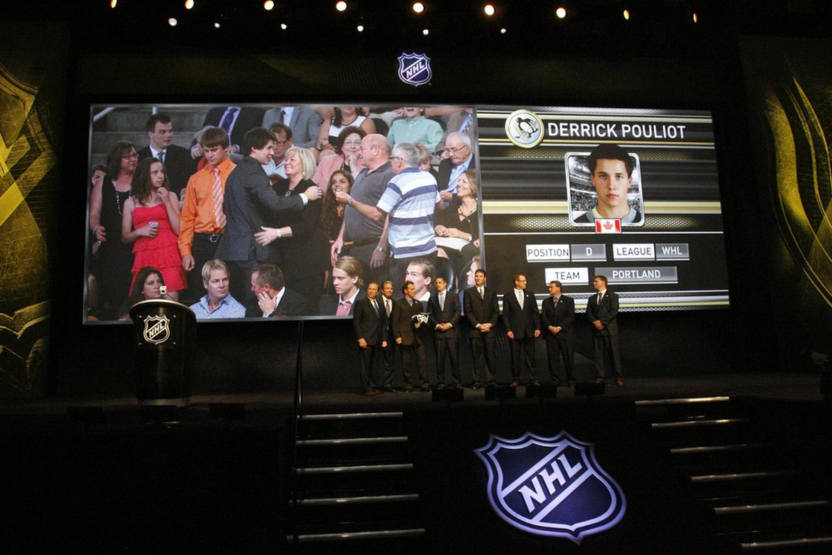 June 22, 2012; Pittsburgh, PA, USA; Derrick Pouliot is shown on the video board after being selected by the Pittsburgh Penguins in the 2012 NHL Draft at CONSOL Energy Center.  Mandatory Credit: Charles LeClaire-US PRESSWIRE