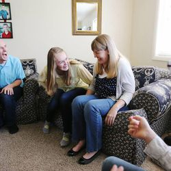 The Evens share a laugh as they play a game after family home evening Monday, May 11, 2015, together at home in Murray.