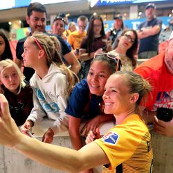 Utah Royals FC forward Amy Rodriguez (8) takes photos with fans after a match against the Orlando Pride at Rio Tinto Stadium in Sandy on Wednesday, May 9, 2018.