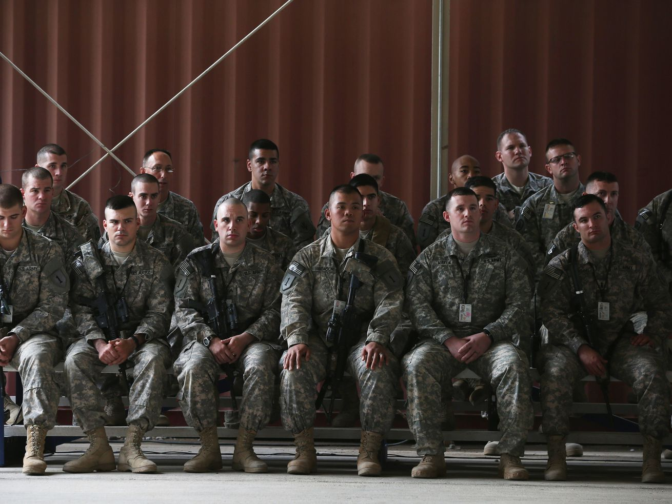 US troops listen to former Secretary of Defense Chuck Hagel speak during a visit to Baghdad, Iraq, on December 9, 2014.