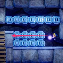 On the left side, destroy the top row of ice blocks.