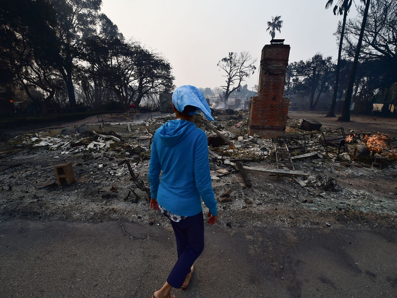 Resident Lea Johnson views the scene November 10, after the Woolsey Fire tore through Point Dume.