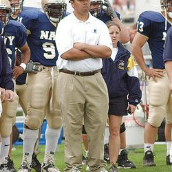 Navy football coach Ken Niumatalolo watches from the sideline during a game against Georgia Tech in 2007. Niumatalolo was promoted to head coach at the end of the 2007 season.