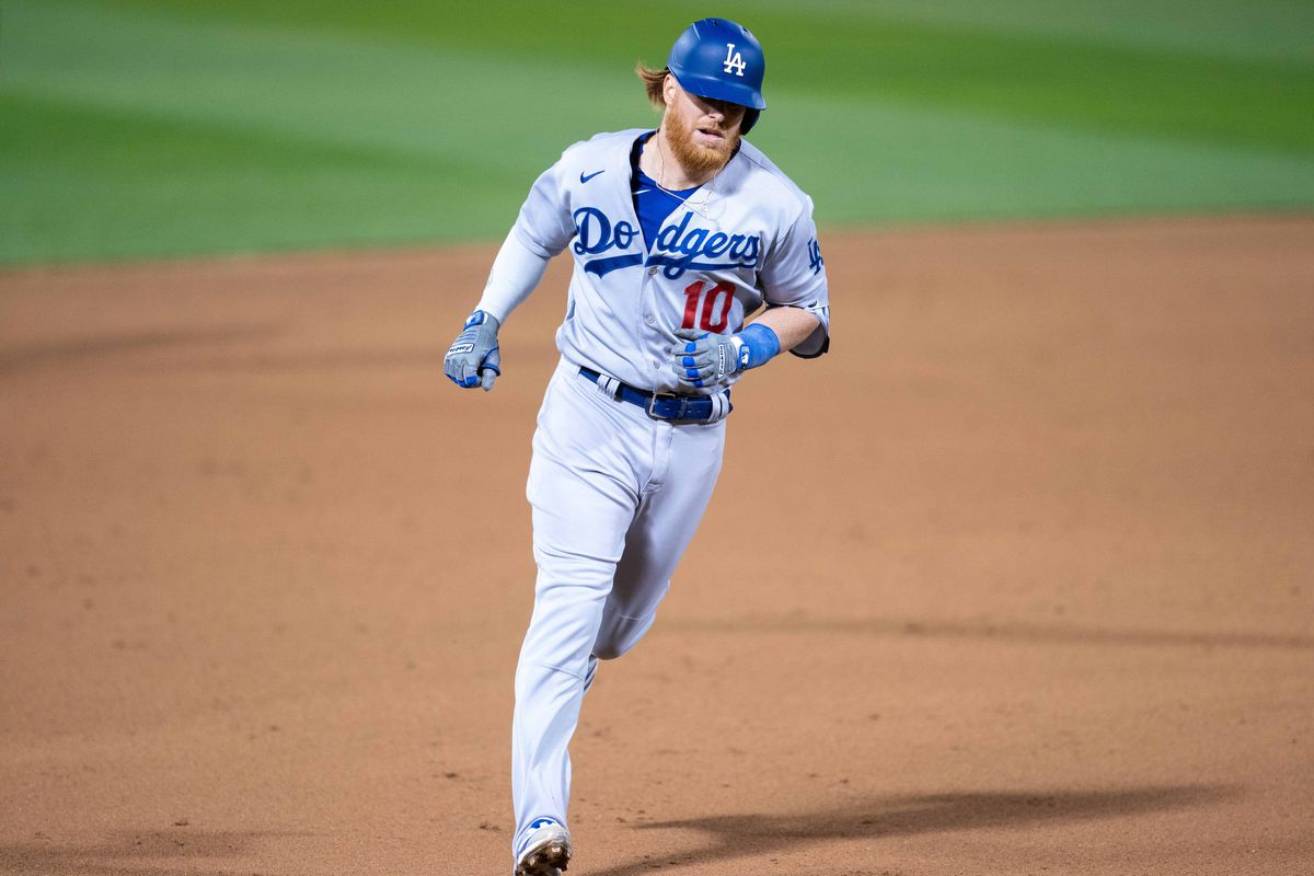 Los Angeles Dodgers third baseman Justin Turner (10) rounds third base after hitting a solo home run against the Oakland Athletics during the eighth inning at RingCentral Coliseum.