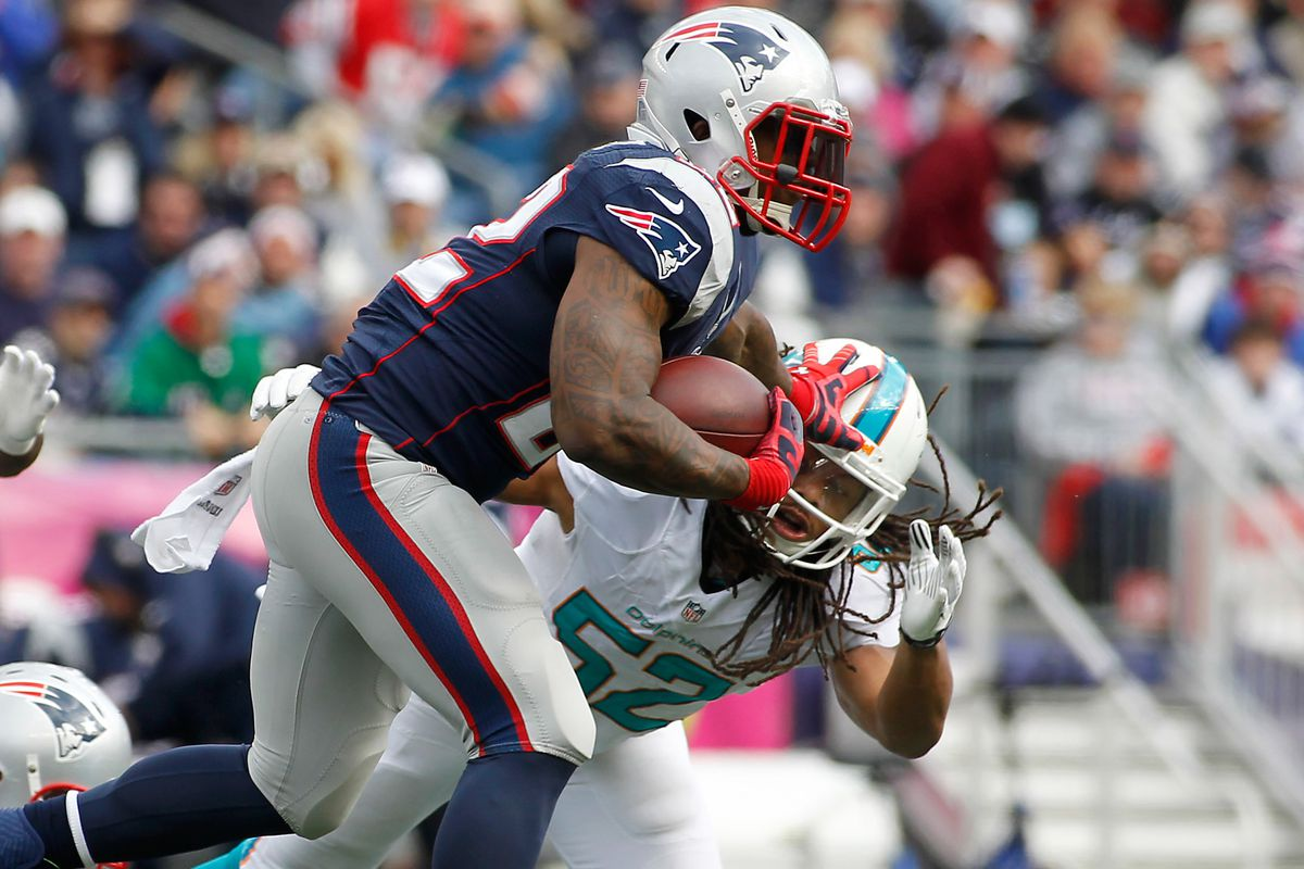 Stevan Ridley uses the classic stiff-arm method to gain separation