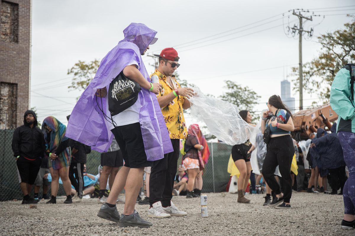 Festival goers wait for Spring Awakening Music Festival: Autumn Equinox to resume Saturday after the grounds were evacuated due to severe weather.