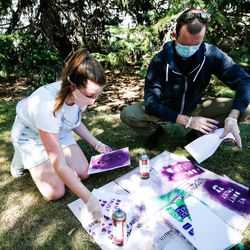 Cassidy Hunsinger, left, makes posters with Mark Schelling on the University of Utah campus in Salt Lake City on Thursday, Aug. 6, 2020. A small group of demonstrators gathered to protest the handling of the Lauren McCluskey case amid recent reports that a police officer showed explicit photos of the slain student to fellow officers.