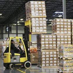 Bishop's Central Storehouse workers load supplies as The Church of Jesus Christ of Latter-day Saints sendsaid to China in Salt Lake City on Wednesday, Jan. 29, 2020. Respirator masks, protective goggles and protective suits were sent.