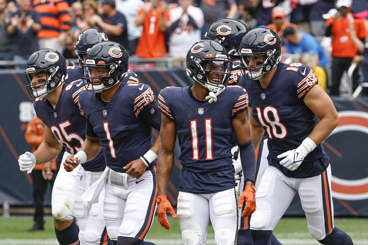 Darnell Mooney and Justin Fields celebrate a Bears rushing touchdown against the Lions.