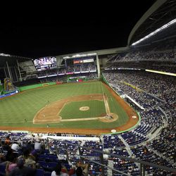 Fans at the new Marlins Park watch a spring training baseball game between the Miami Marlins and the New York Yankees, Monday, April 2, 2012, in Miami. The Yankees won 5-2.