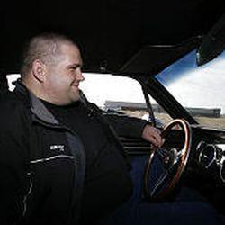 Rulon Gardner drives his vintage Mustang in North Salt Lake.