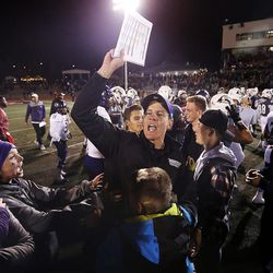 Weber State Wildcats head coach Jay Hill celebrates with family and fans after the Wildcats defeat the Southern Utah Thunderbirds in NCAA football in Cedar City on Saturday, Dec. 2, 2017.
