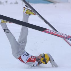 Matti Hautamaeki, of Finland, falls after landing at the 120k jump at the Utah Olympic Park during the team 120k competition February 18, 2002.