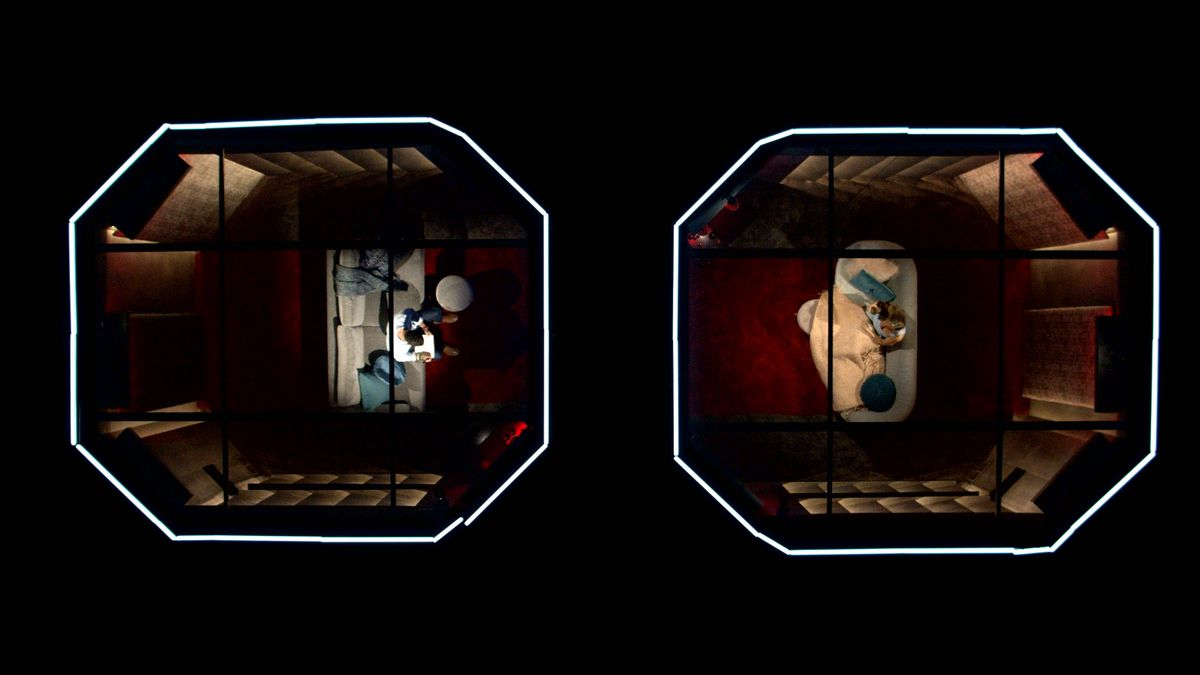 Two of the octagonal isolation pods in Love Is Blind are seen from overhead, with participants in the reality show sitting on white couches on dark red carpets.