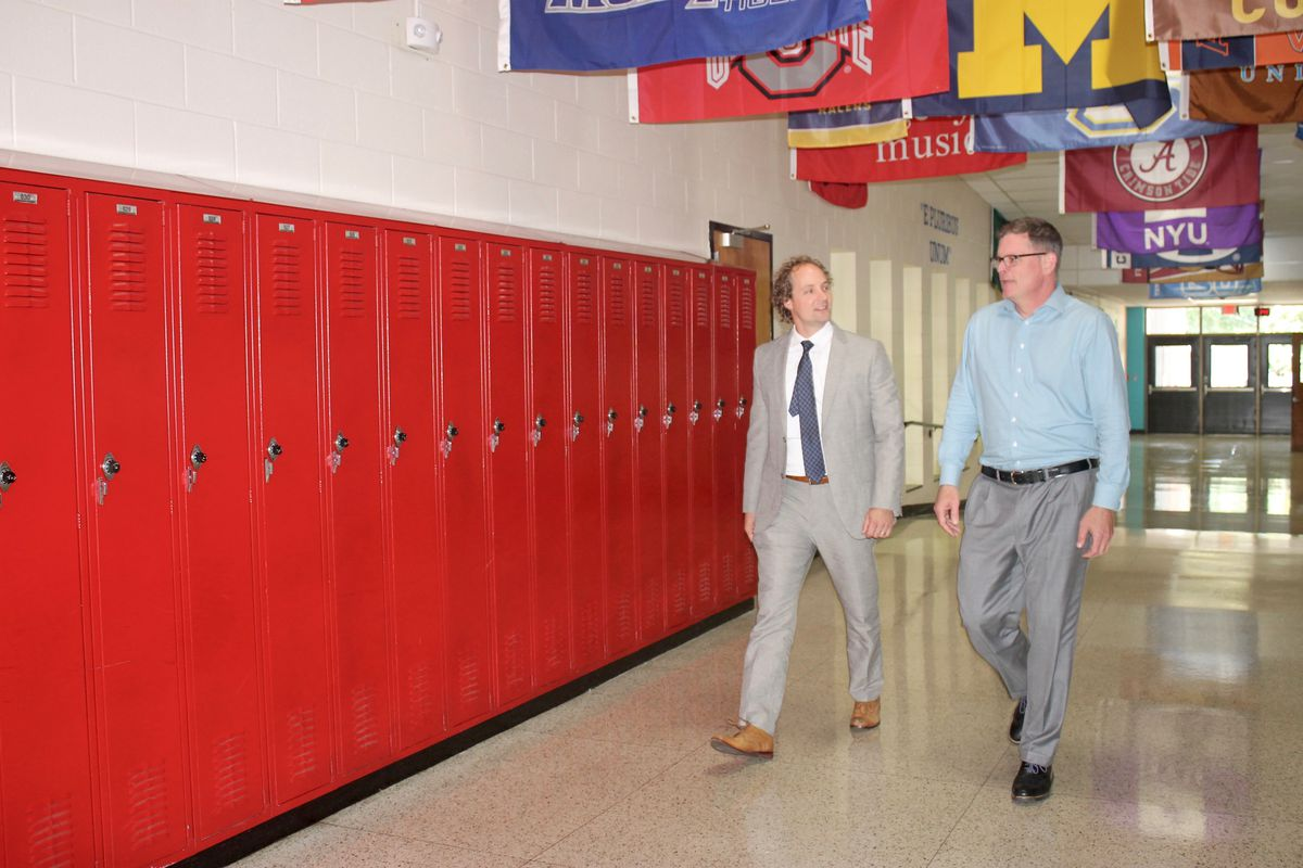 Principal Gary Hughes (right) talks with his supervisor, Craig Hammond, at Nashville's J.T. Moore Middle School. Hammond spends a half day every other week working collaboratively with Hughes under an emerging administrative support and coaching model used by Metropolitan Nashville Public Schools.
