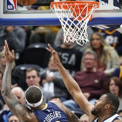 New Orleans Pelicans center DeMarcus Cousins (0) hooks the ball over the outstretched arm of Utah Jazz forward Derrick Favors (15) as Utah hosts New Orleans at Vivint Arena in Salt Lake on Friday, Dec. 1, 2017.