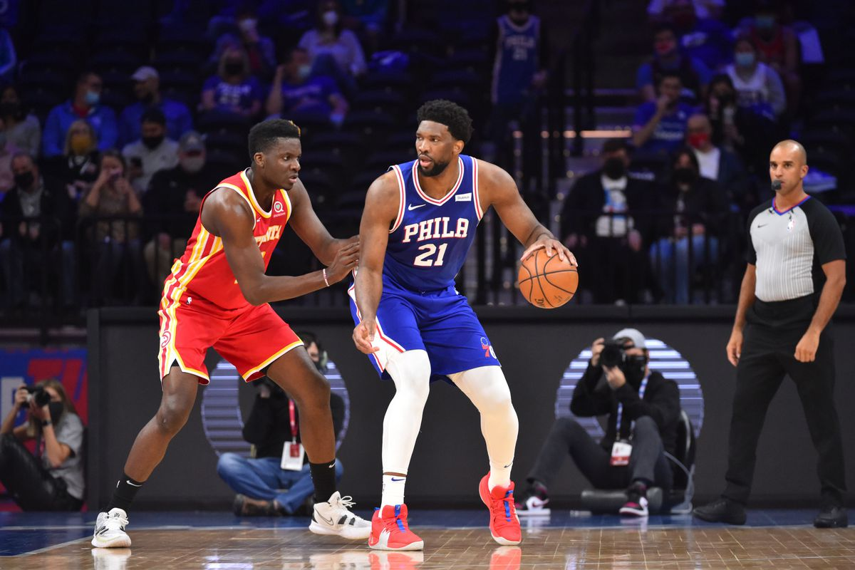 Joel Embiid of the Philadelphia 76ers handles the ball against Clint Capela of the Atlanta Hawks on April 30, 2021 at Wells Fargo Center in Philadelphia, Pennsylvania.