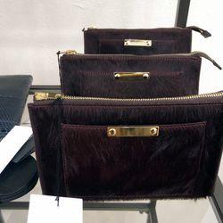 Sophie Hulme calfhair clutches, $108