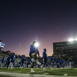 Brigham Young Cougars warm up before the start of the NCAA football game between Brigham Young Cougars and the Utah State Aggies at Maverik Stadium in Logan on Saturday, November 2, 2019.