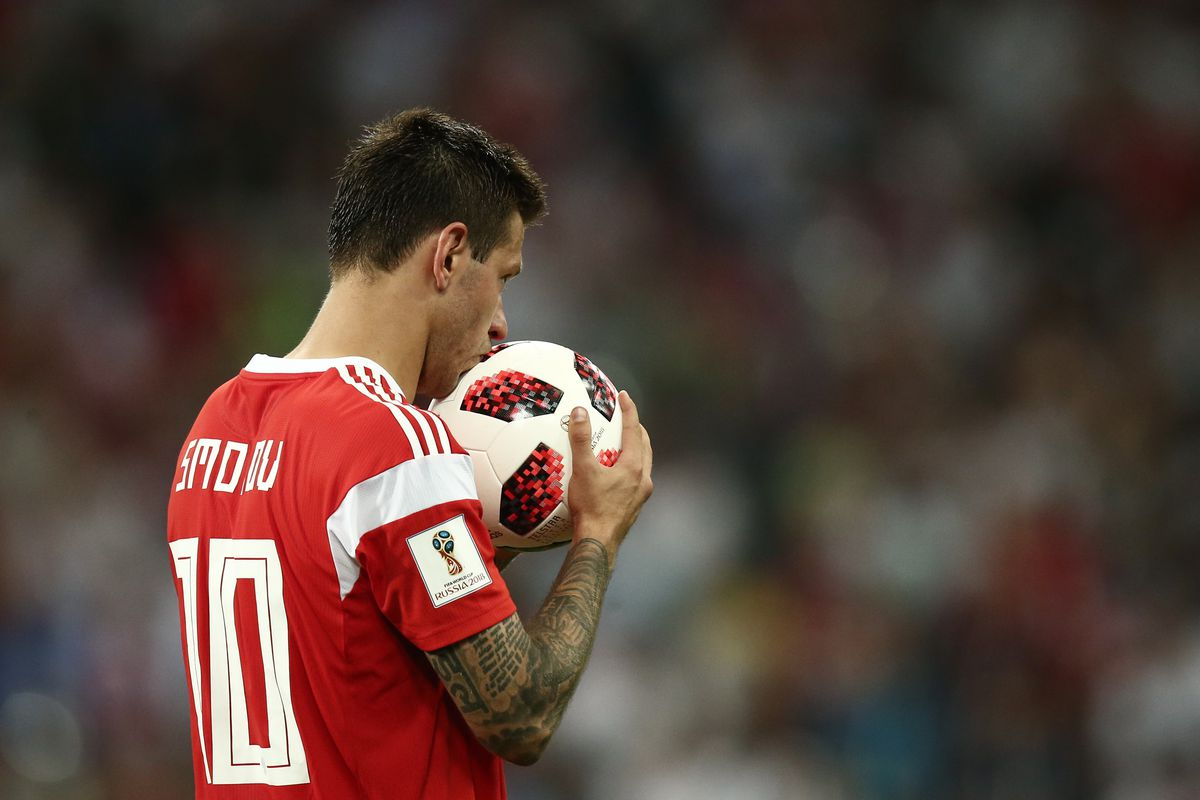 Russian forward Fyodor Smolov kisses the ball during a penalty against Croatia at the 2018 World Cup. Smolov missed his shot.
