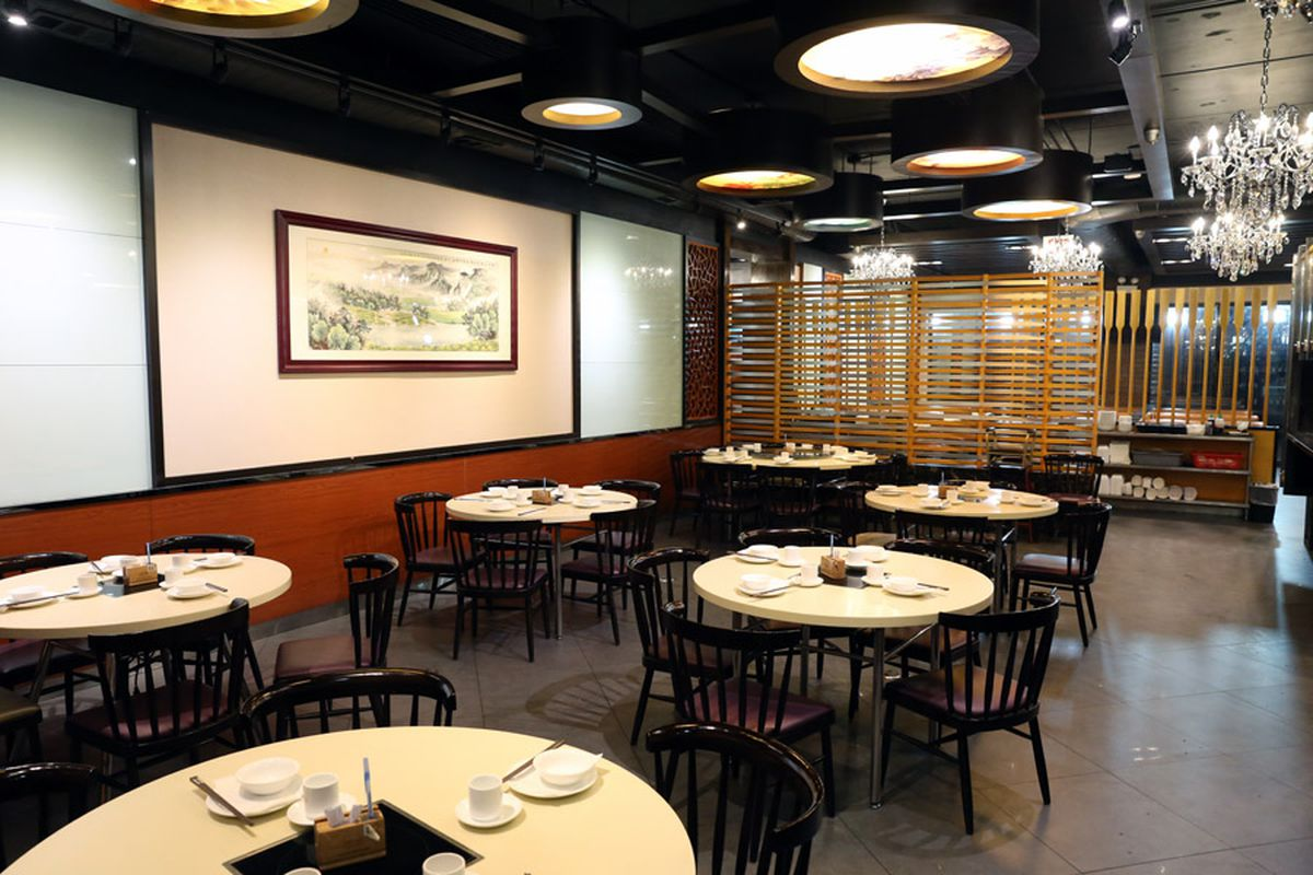 Six circular Chinese dim sum tables sit in a dining room.