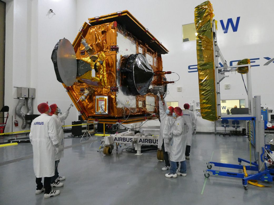 Sentinel-6 team members Michael Freilich of the European Space Agency posed with the spacecraft during processing.