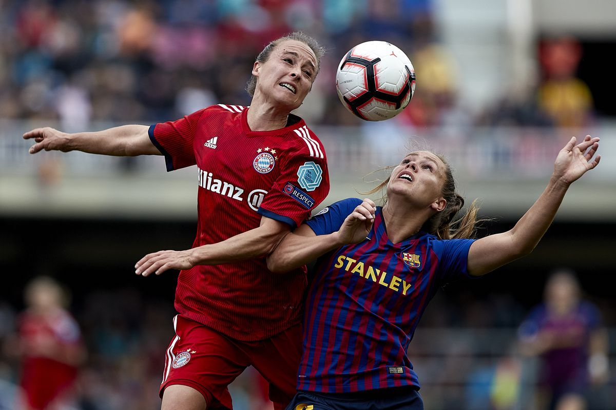 BARCELONA, SPAIN - APRIL 28: Lieke Martens of FC Barcelona competes for the ball with Gina Lewandowski of FC Bayern Munich during the UEFA Women's Champions League semi final second Leg match between FC Barcelona and FC Bayern Munich at at Mini Estadi on April 28, 2019 in Barcelona, Spain.