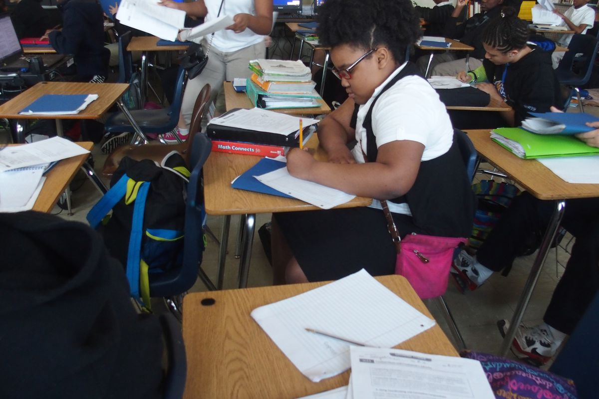 A student at Treadwell Middle School in Memphis finishes a class assignment.  Treadwell is among 13 schools in the Innovation Zone within Shelby County Schools.