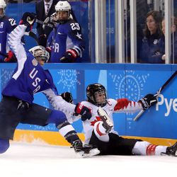 Megan Keller #5 of the United States collides with Marie-Philip Poulin #29 of Canada and is called for an illegal hit in overtime.