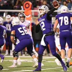 Lehi's Cammon Cooper winds up for a pass in the 5A football state championship game at Rice-Eccles Stadium in Salt Lake City on Friday, Nov. 17, 2017.