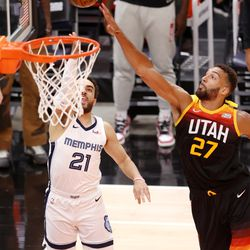 Memphis Grizzlies guard Tyus Jones (21) gets up a shot with Utah Jazz center Rudy Gobert (27) defending as the Utah Jazz and Memphis Grizzlies play Game 2 of their NBA playoffs first round series at Vivint Arena in Salt Lake City on Wednesday, May 26, 2021.