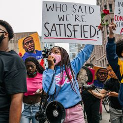 People march during an inaugural remembrance demonstration for George Floyd on May 23, 2021 in Minneapolis, Minnesota.
