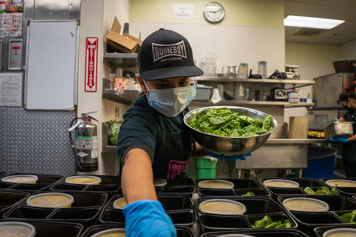 Worker preps a dish at Homeboy Industries