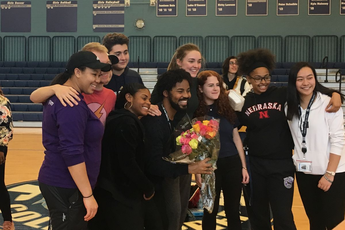 Brian Coleman, pictured center with flowers, poses with students from Jones College Prep on the day of his announcement