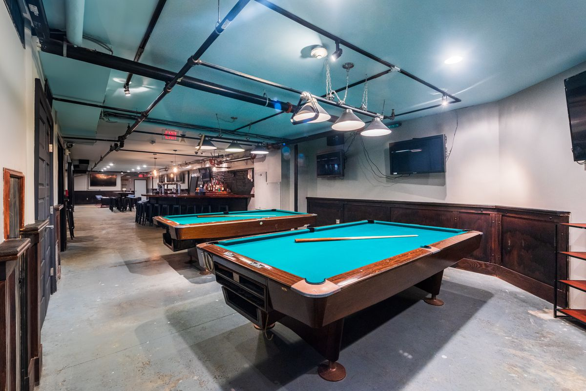 Two pool tables take up space at one of the bar at Thirsty Crow